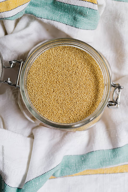 Amaranth grain in a jar by Alessio Bogani for Stocksy United
