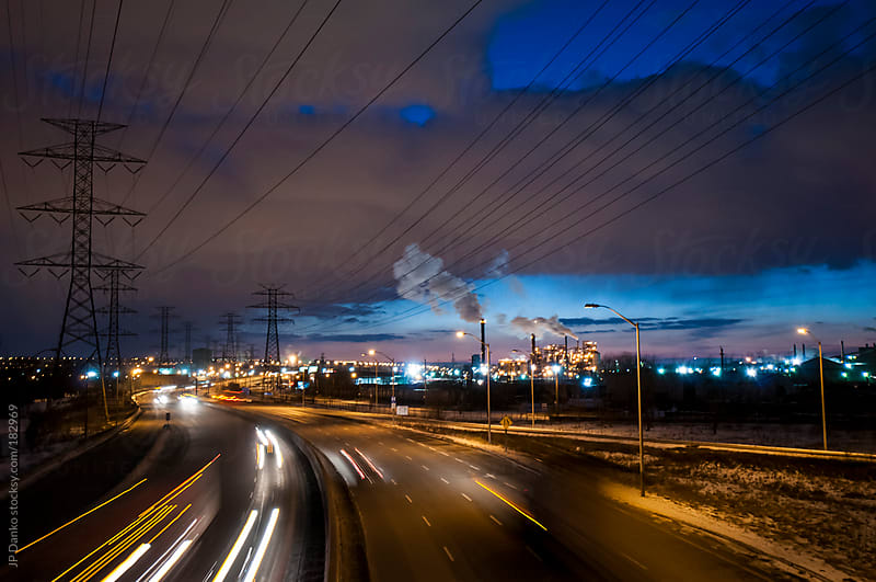 Large Highway Through Urban Industrial Zone at Night by JP Danko for Stocksy United