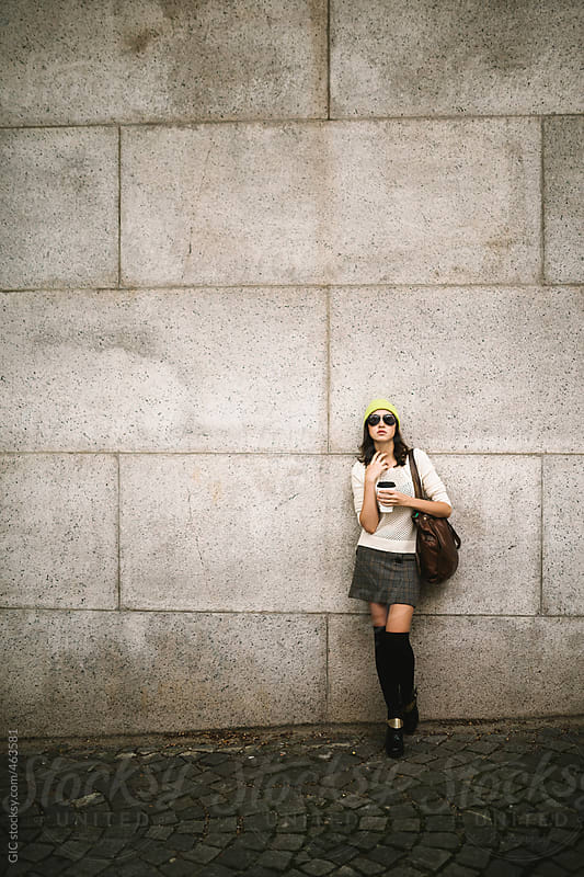 Young attractive casual woman against a wall by GIC for Stocksy United