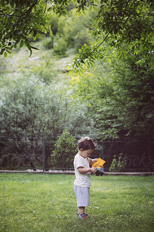 Little boy playing with toy by Ani Dimi for Stocksy United
