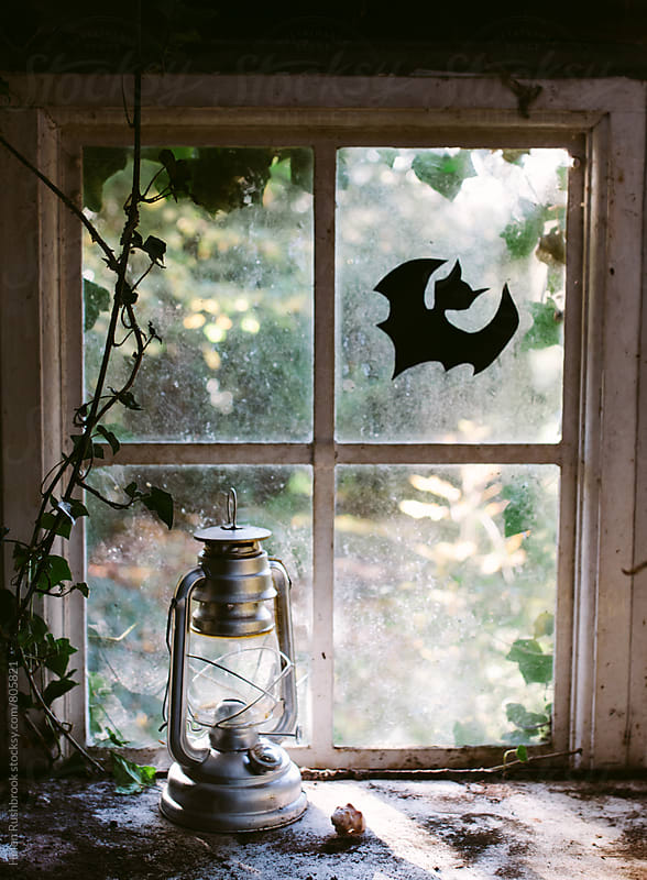 A slightly spooky window by Helen Rushbrook for Stocksy United