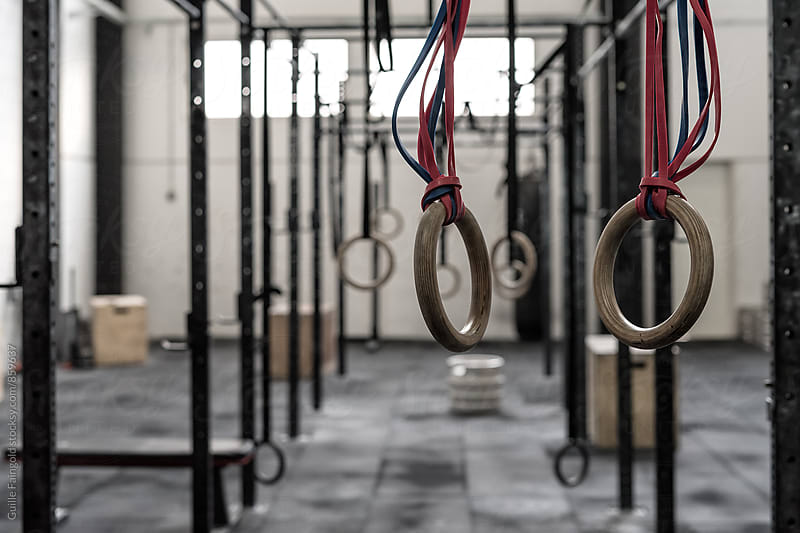 gymnastic rings in a  gym by Guille Faingold for Stocksy United