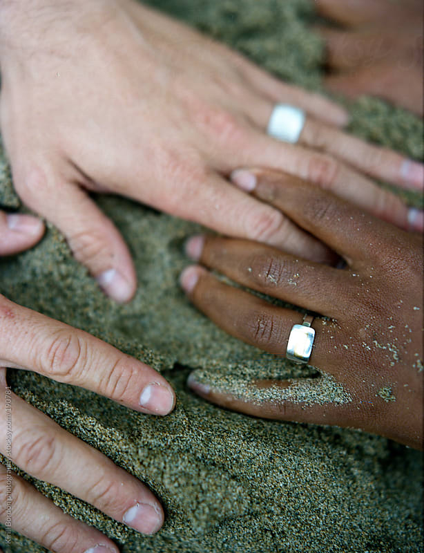sandy hands by Kirill Bordon photography for Stocksy United