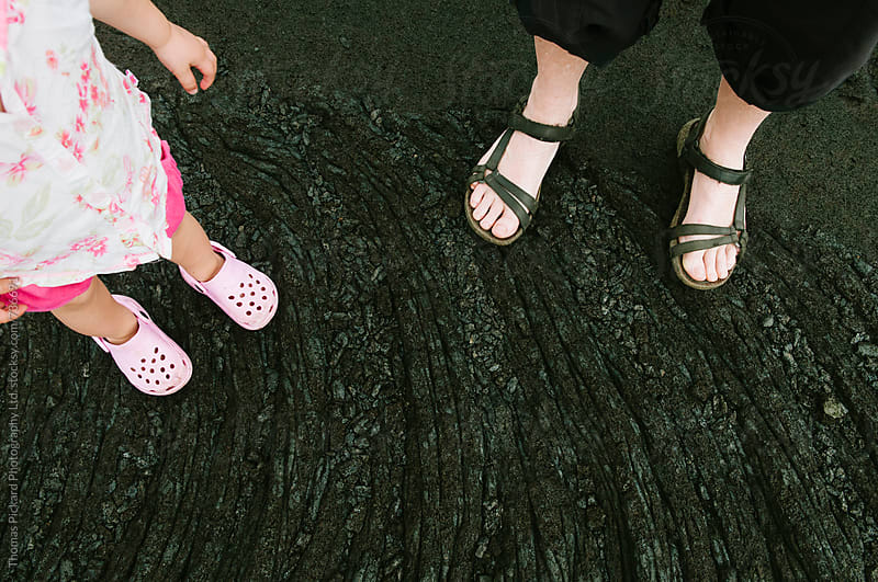 Girl toddler and mother standing on lava, Samoa. by Thomas Pickard for Stocksy United