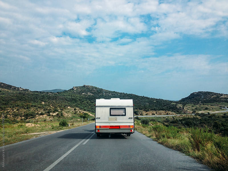 Camping trailer on the road by Aleksandra Kovac for Stocksy United