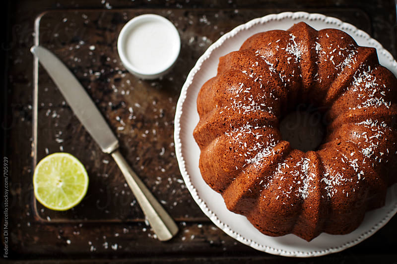 Coconut milk and lime bund cake  by Federica Di Marcello for Stocksy United