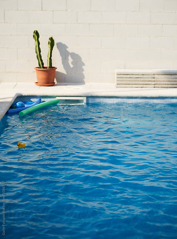 Empty swimming pool  by Guille Faingold for Stocksy United