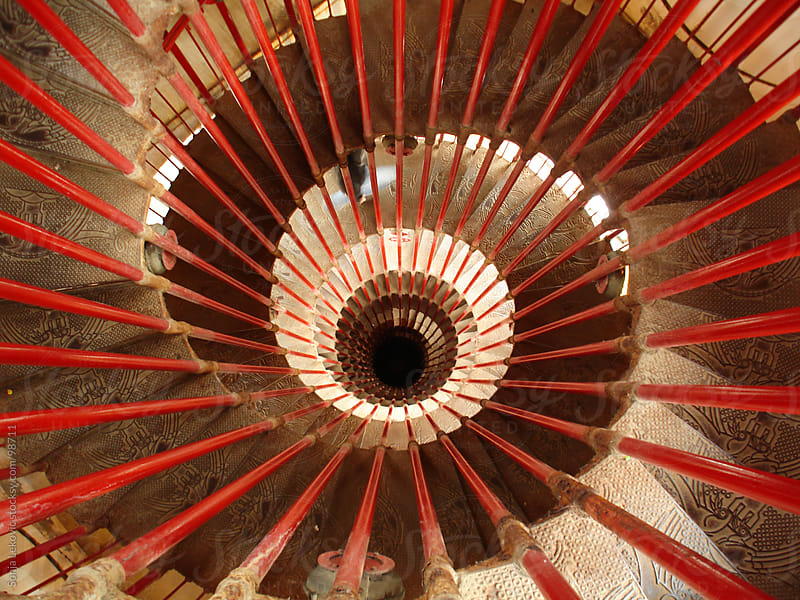 red spiral stairs by Sonja Lekovic for Stocksy United