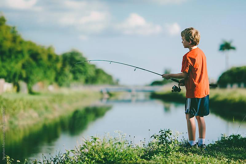 Boy Fishing by Stephen Morris for Stocksy United