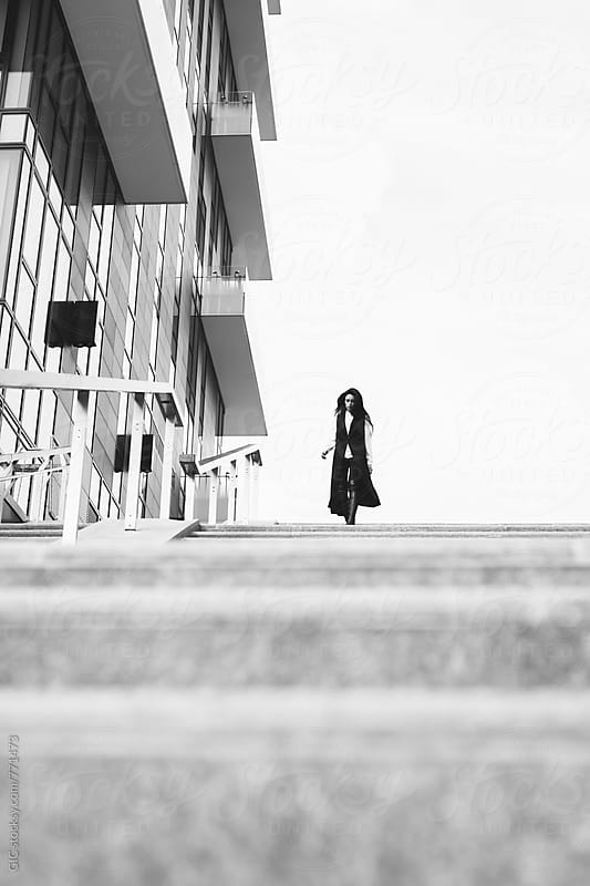 Stylish fashion woman in abstract urban area by Simone Becchetti for Stocksy United