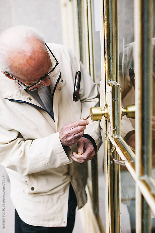 Elderly man opening the door of house. by BONNINSTUDIO for Stocksy United