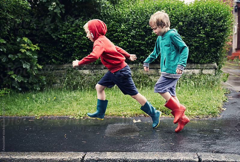 Two children outdoors on a rainy day by sally anscombe for Stocksy United