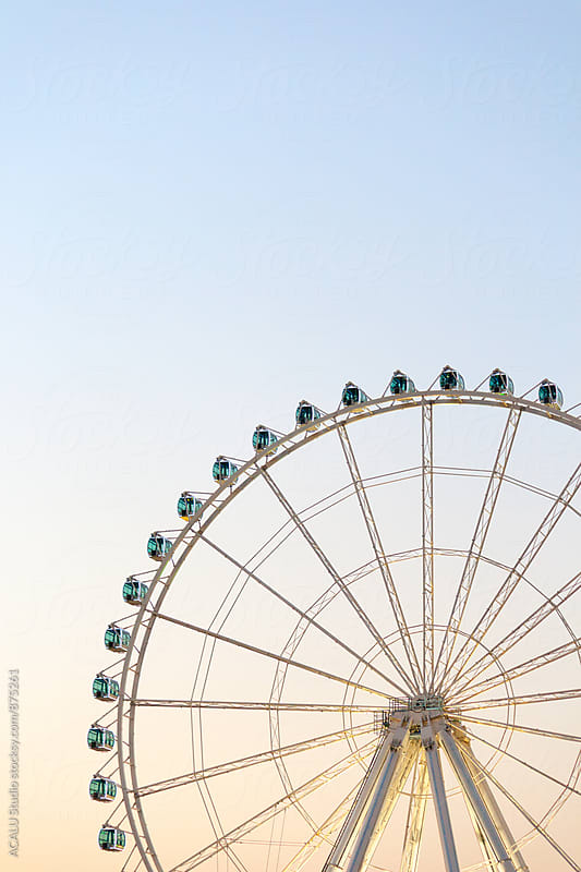 Ferris wheel at sunset by ACALU Studio for Stocksy United