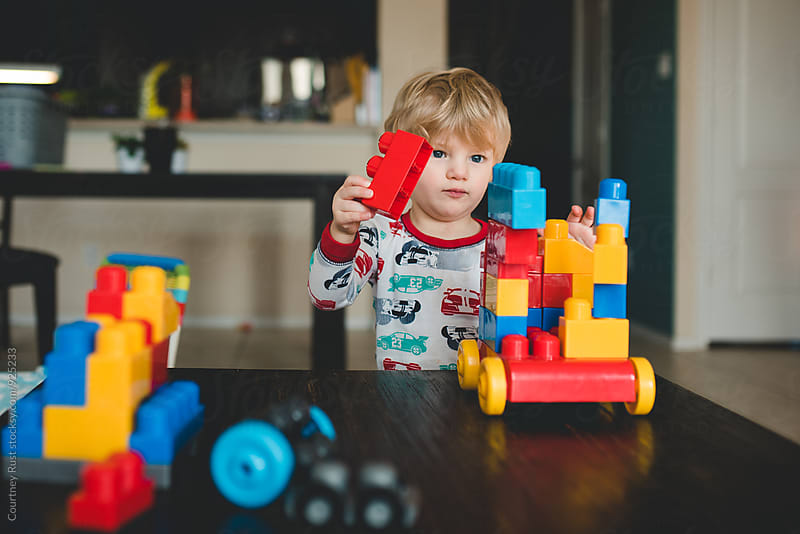 Toddler building with blocks by Courtney Rust for Stocksy United