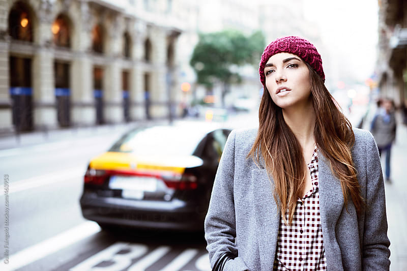 Beautiful female walking around streets of Barcelona by Guille Faingold for Stocksy United