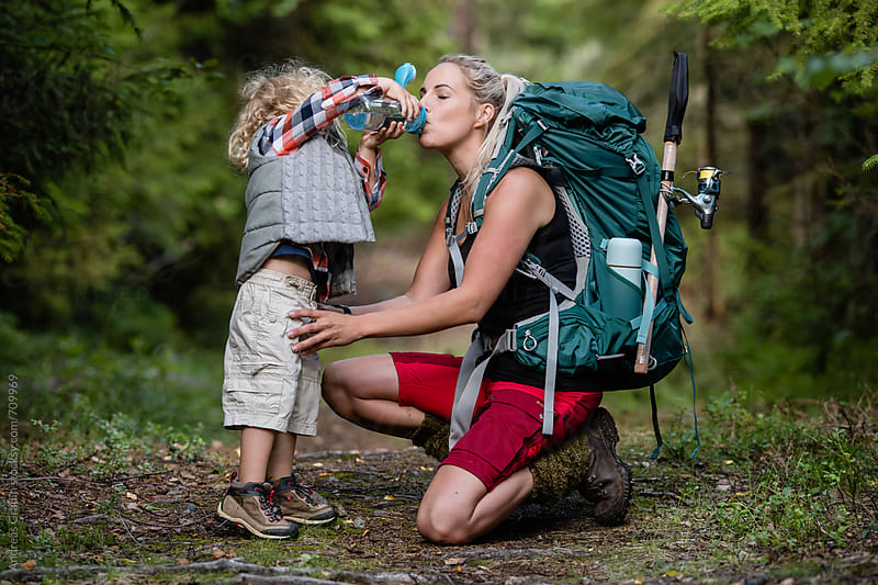 hiking mom and son by Andreas Gradin for Stocksy United