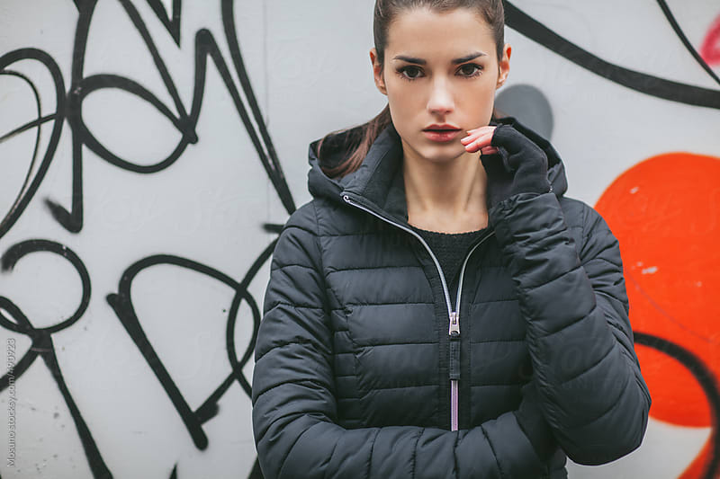 Young Woman Posing in a Black Winter Jacket by Mosuno for Stocksy United