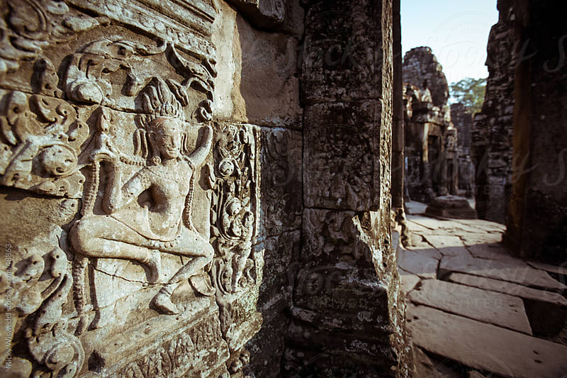 Intricate carvings of Bayan Temple in Angkor Wat by Micky Wiswedel for Stocksy United