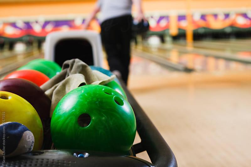 Bowling: Focus On Ball In Return Rack by Sean Locke for Stocksy United