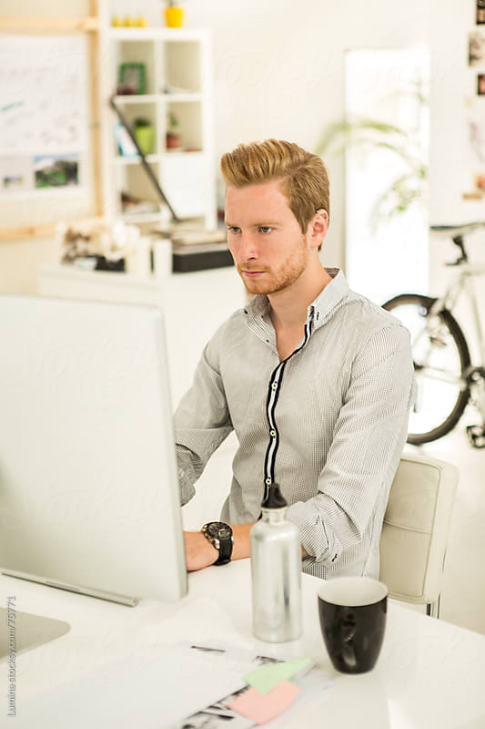 Young Businessman Working at His Computer by Lumina for Stocksy United