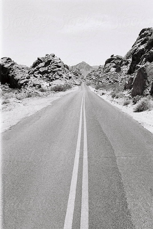 Road through valley of fire black and white film by Jesse Morrow for Stocksy United