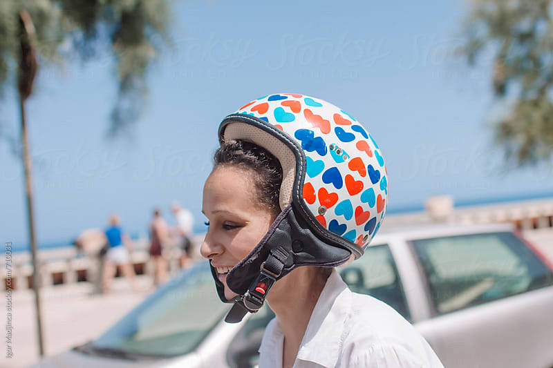 colorful hearts on the helmet,pretty girl rides a motorcycle,love by Igor Madjinca for Stocksy United