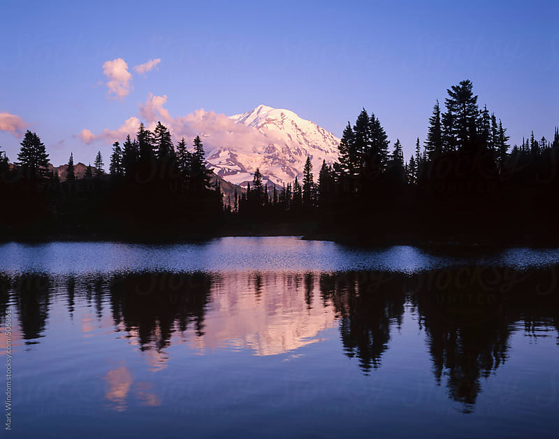 Mount Rainier reflected in a lake at sunset by Mark Windom for Stocksy United