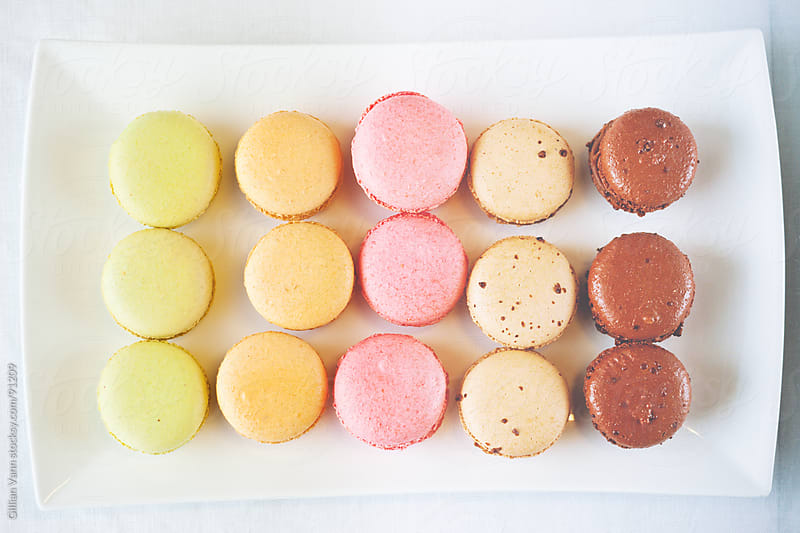 macarons on a plate by Gillian Vann for Stocksy United