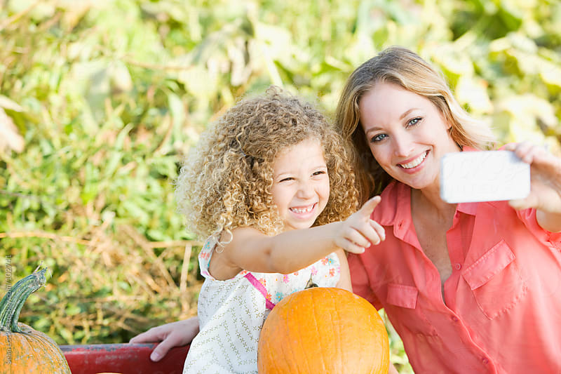Pumpkins: Taking A Photo In The Pumpkin Patch by Sean Locke for Stocksy United