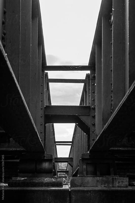 Black and white image the gap between two bridges by Melanie Kintz for Stocksy United