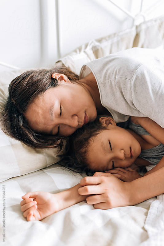 Young mother and her daughter sleeping by MaaHoo Studio for Stocksy United