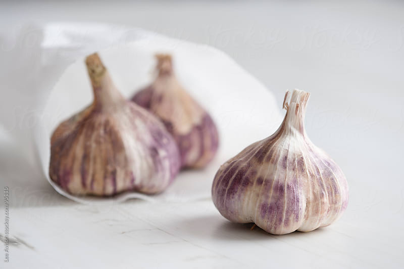 garlic bulbs by Lee Avison for Stocksy United