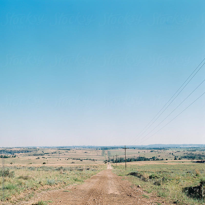 Dusty road to Johannesburg by Andrew Spencer for Stocksy United
