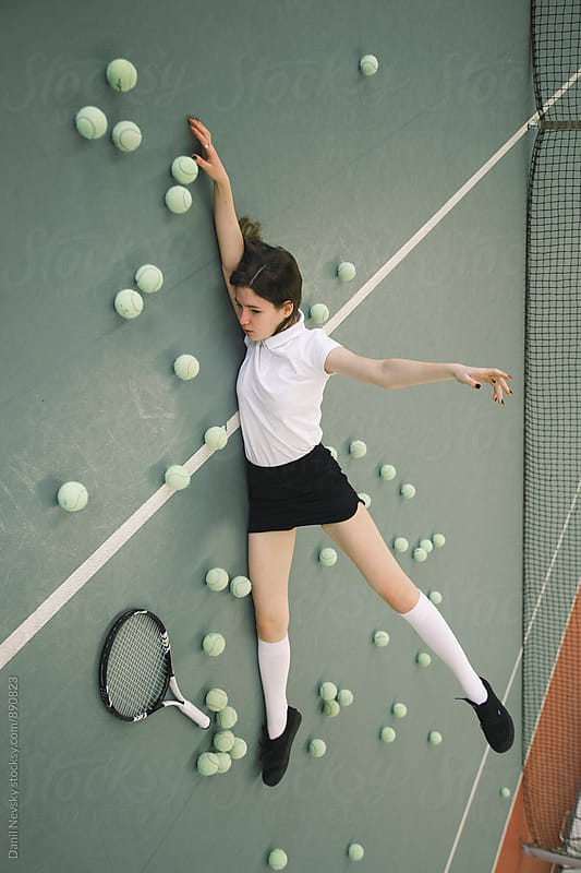 Young woman on court with tennis balls by Danil Nevsky for Stocksy United