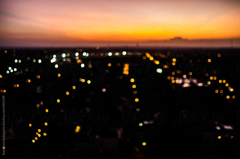 Out of focus city lights during sunset by Suprijono Suharjoto for Stocksy United