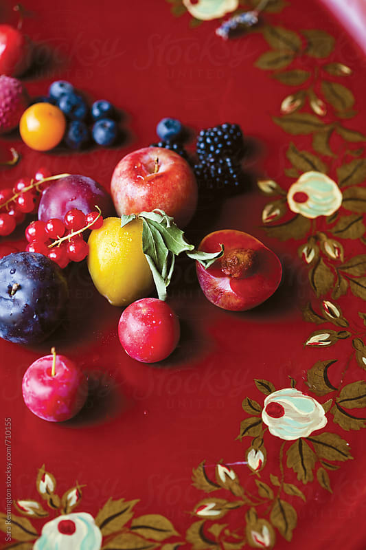 Fruit on Red Platter by Sara Remington for Stocksy United
