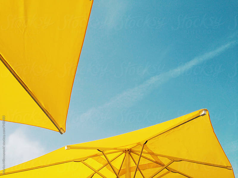 Under yellow umbrella by Marko Milovanović for Stocksy United