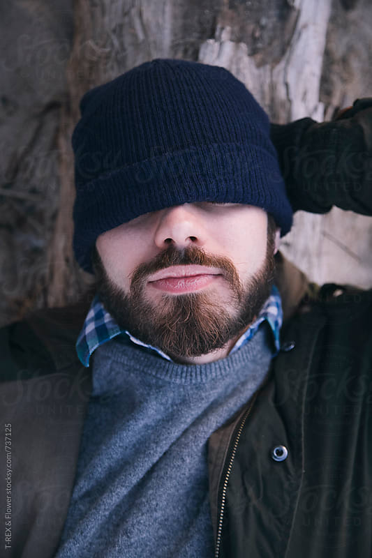 Bearded man sleeping outdoor by Danil Nevsky for Stocksy United