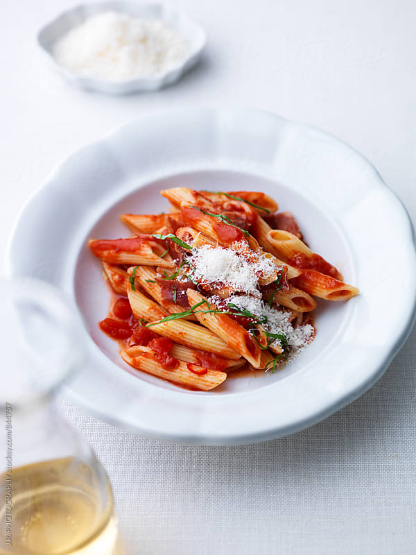 Penne all arrabiata by J.R. PHOTOGRAPHY for Stocksy United