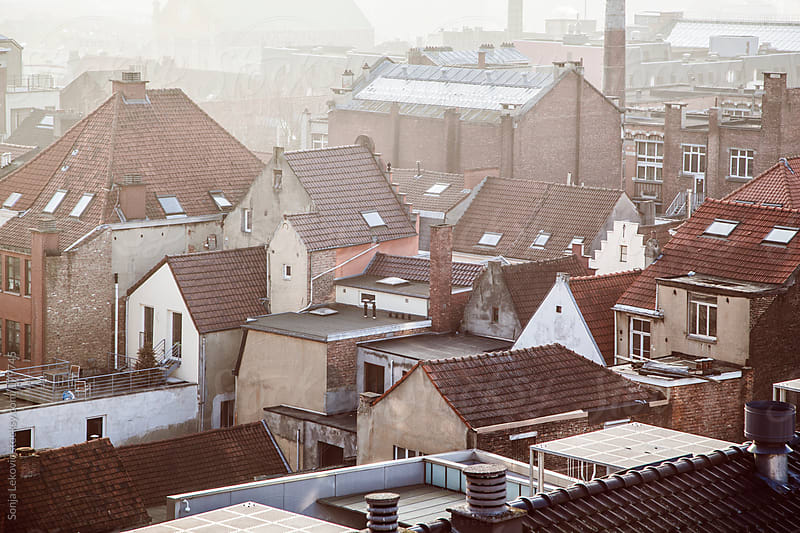 brown houses and roofs by Sonja Lekovic for Stocksy United