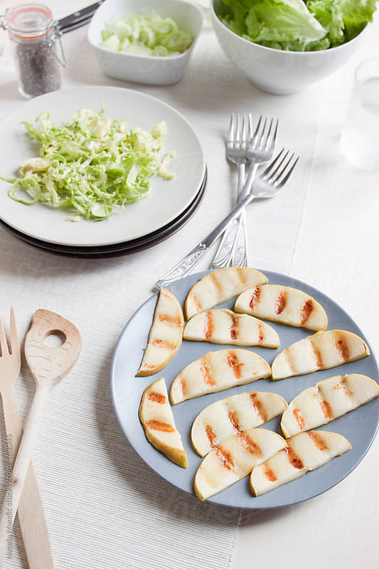 Grilled apples and brussel sprouts by Nataša Mandić for Stocksy United