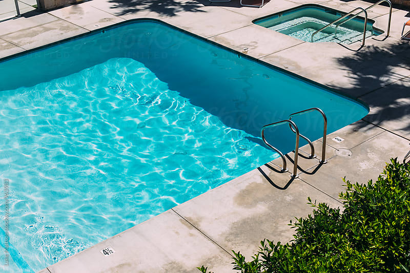 Step Ladder Leading Into Bright Blue Swimming Pooll by Luke Mattson for Stocksy United