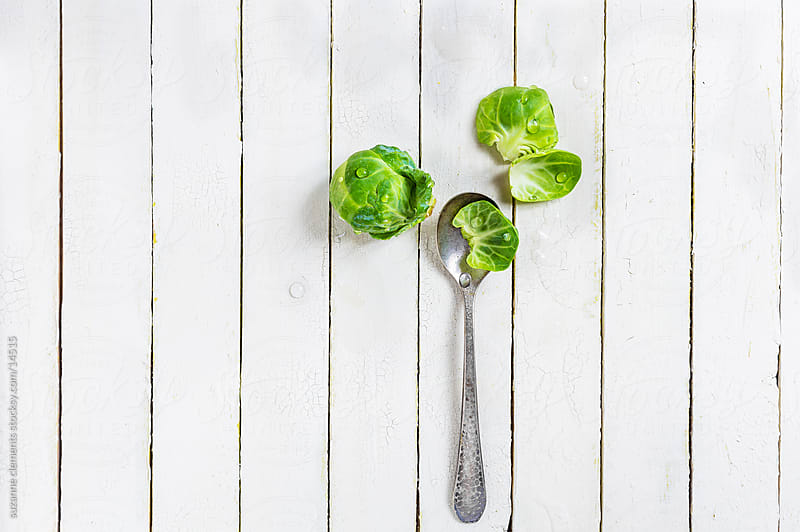 Fresh Organic Brussels Sprouts and Spoon by suzanne clements for Stocksy United