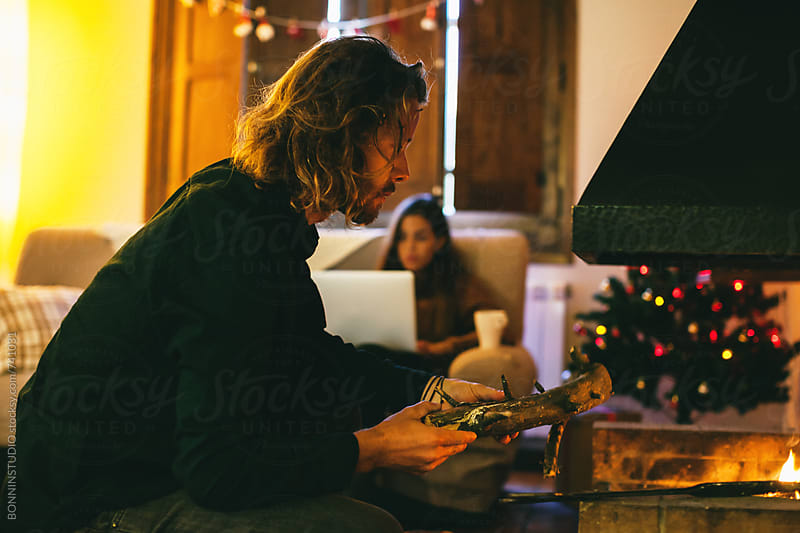 Couple at home on Christmastime. by BONNINSTUDIO for Stocksy United
