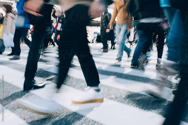 Blurred Legs of People Crossing Shibuya Crossing in Tokyo by VISUALSPECTRUM for Stocksy United