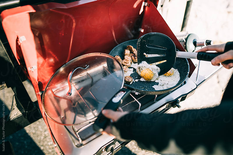 Hand making breakfast by Isaiah & Taylor Photography for Stocksy United