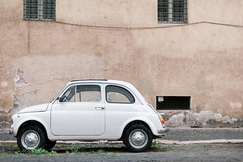 Small Retro Car Parked on the Street In Rome, Italy by Briana Morrison for Stocksy United
