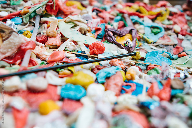 Chewed bubble gum stuck on a wall in colorful patters and colors by Mihael Blikshteyn for Stocksy United