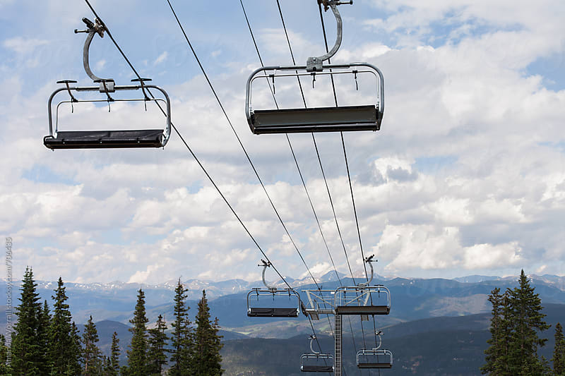 Chair lifts at a ski resort in the summer by Amanda Worrall for Stocksy United