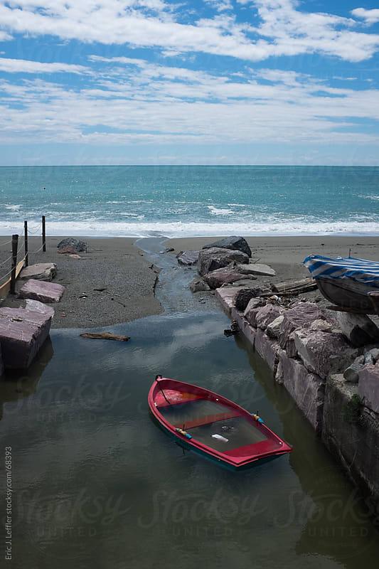Sinking Red Boat by Eric J. Leffler for Stocksy United